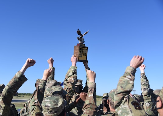 The 315th Training Squadron drill team holds the trophy for best drill team in the air following the 17th Training Group drill competition