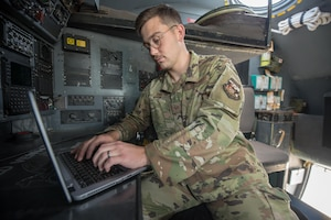 Staff Sgt. Harrison Jenkins, an intelligence analyst with the Kentucky Air National Guard's 123rd Operations Support Squadron, performs inflight aircrew training aboard a C-130 Hercules at Muñiz Air National Guard Base in Carolina, Puerto Rico, on June 16, 2021. Jenkins is the Kentucky Air National Guard's Outstanding Airman of the Year for 2021. (U.S. Air National Guard photo by Phil Speck)