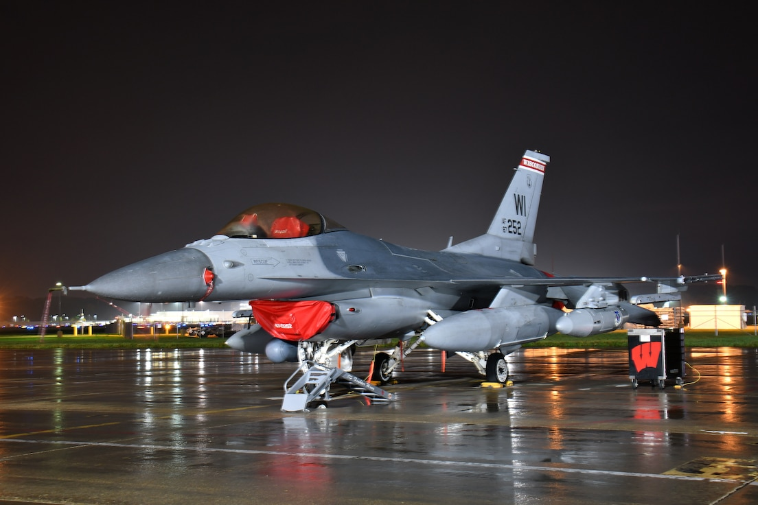 An F-16C Fighting Falcon aircraft assigned to the Wisconsin Air National Guard's 115th Fighter Wing sits ready to depart for an aerospace expeditionary force deployment from Truax Field in Madison, Wisconsin, October 11, 2021. The departure was the unit's final deployment of F-16s before undergoing a scheduled transition to F-35 Lightning II aircraft in 2023. (U.S. Air National Guard photo by Senior Master Sgt. Paul Gorman)