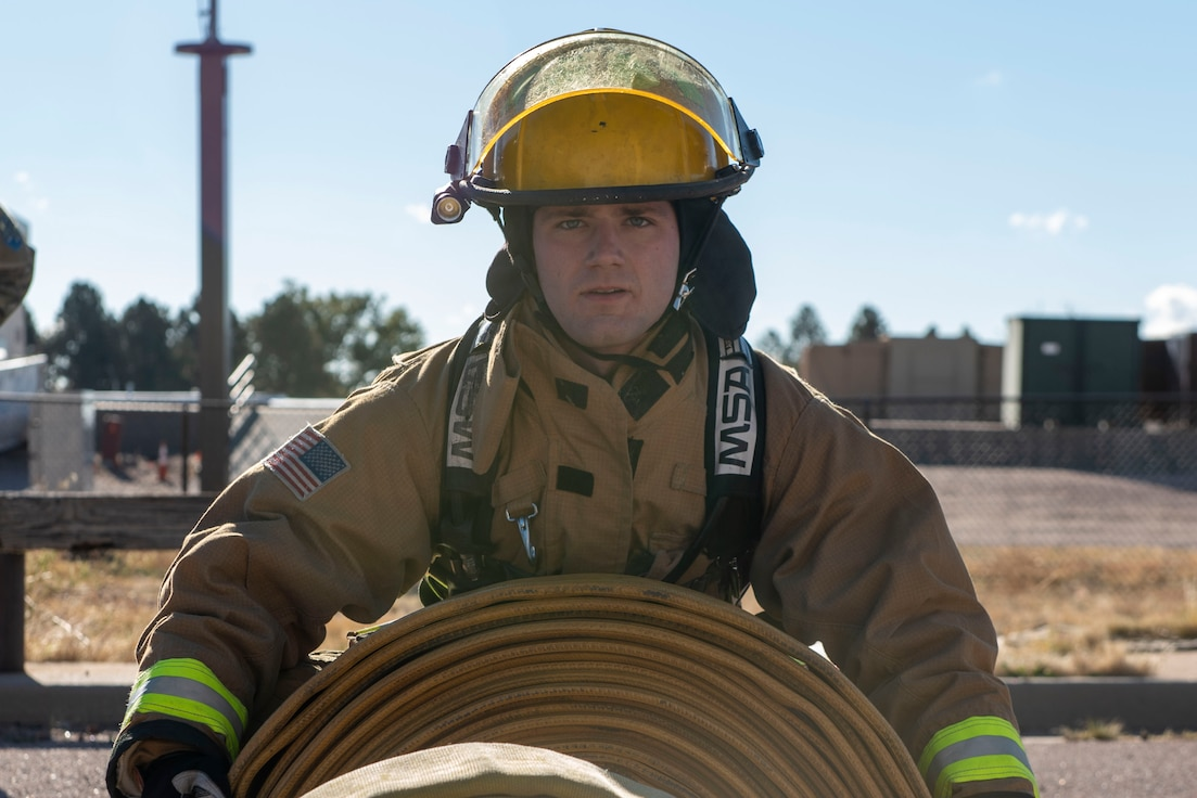 A firefighter posing for a photo