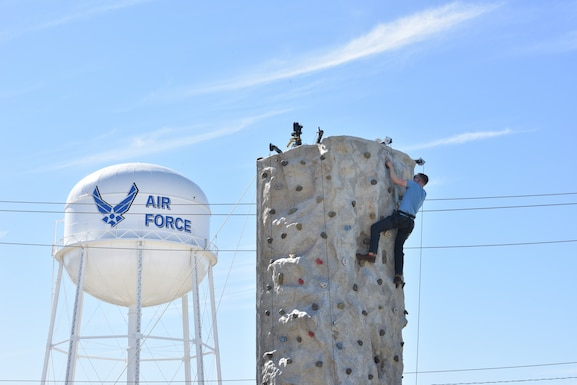 A Goodfellow member climbs a rock-wall during the Oktoberfest at Goodfellow celebration at the Event Center Complex on Goodfellow Air Force Base, Texas, Oct. 16, 2021. The celebration included live music, German food, rock climbing, and other family-friendly activities. (U.S. Air Force photo by Senior Airman Ashley Thrash)