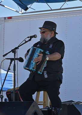 A local musician performs at the Oktoberfest at Goodfellow celebration at the Event Center Complex on Goodfellow Air Force Base, Texas, Oct. 16, 2021. Oktoberfest brought German culture to Goodfellow and allowed Airmen and their families to celebrate German heritage without travelling outside the local area. (U.S. Air Force photo by Senior Airman Ashley Thrash)