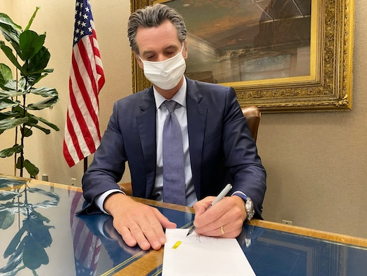 photo of California Governor signing a bill