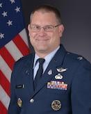 Air Force male in service dress uniform.