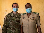 Indiana National Guard Cpt. Jennifer Nevers, a behavioral health officer with the Indiana National Guard's 738th Medical Company Area Support, meets Lt. Col. Aichatou Ousmane Issaka, the Niger Armed Forces director of psychological and social services, in Niamey, Niger, to strategize on mental health issues for the military. The Indiana Guard and Niger are partners under the National Guard State Partnership Program.