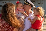 Service member greets family