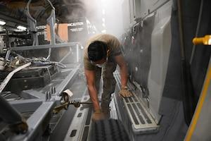 Photo of U.S. Airman working inside aircraft
