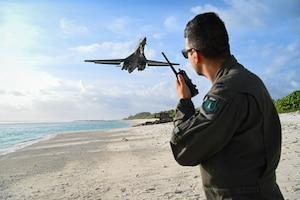 Photo of U.S. Air Force Airman watching flight of B-1 Lancer