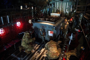 U.S. Air Force Airmen from the 435th Contingency Response Squadron secure a load to a C-130J Super Hercules during Operation Castle Forge at Larissa Air Base, Greece, Oct. 15, 2021. The 435 CRS is a scalable, cross-functional, rapidly deployable force designed to assess and open air bases, and perform initial airfield operations enabling the rapid standup of combat operations. Castle Forge is a U.S. Air Forces Europe-Air Forces Africa-led joint, multinational training event. It provides a dynamic, partnership-focused training environment that raises the U.S. commitment to collective defense in the Black Sea region while enhancing interoperability alongside NATO allies. (U.S. Air Force photo by Senior Airman Branden Rae)