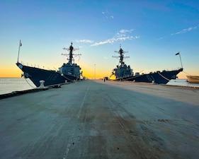 USS Ramage (DDG 61) and USS Daniel Inouye (DDG 118) are pierside at Naval Station Norfolk.