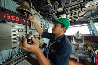 A Sailor stands boatswain's mate of the watch aboard USS Makin Island (LHD 8).