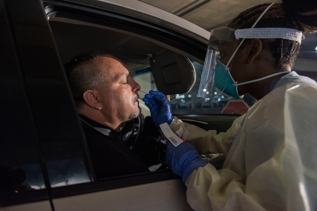 59th Medical Wing Airmen conduct drive-through COVID-19 testing