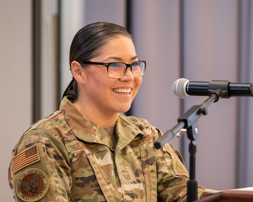 Senior Master Sgt. Christian Johnson, Air Force Chief of Staff superintendent, speaks during the Hispanic Heritage Month Luncheon at Dover Air Force Base, Delaware, Oct. 15, 2021. During her speech, Johnson spoke about breaking traditional gender roles within her Mexican culture by joining the military and opened up about some of the challenges she faced as an immigrant in the armed forces. (U.S. Air Force photo by Mauricio Campino)