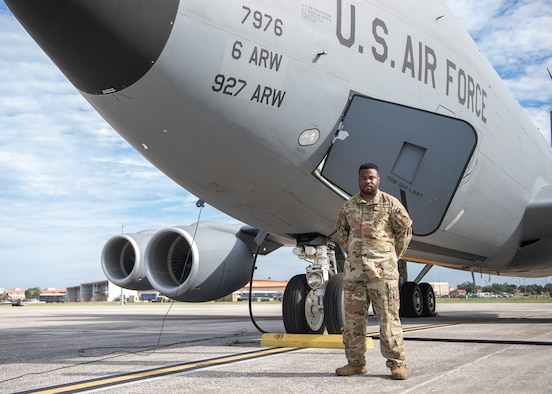 U.S. Air Force MSgt. Michael Fulton, 50th Air Refueling Squadron superintendent, pauses for a photo in front of a KC-135 Stratotanker aircraft on the flight line Oct. 6, 2021, at MacDill Air Force Base, Florida.