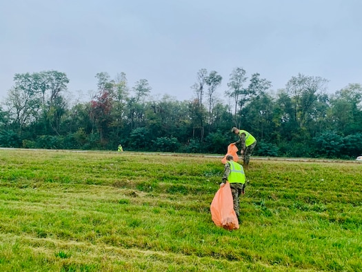 Volunteers from the National Air and Space Intelligence Center on Wright-Patterson Air Force Base pick up trash Oct. 7 on state Route 444 as part of an Adopt-A-Highway community-cleanup program with the Ohio Department of Transportation. (Contributed photo)