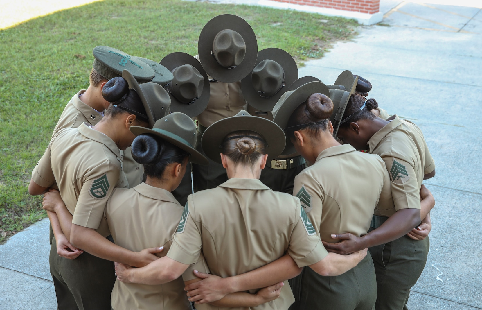 Marines with Oscar Company, 4th Recruit Training Battalion, pray before introducing themselves to their new platoons on Marine Corps Recruit Depot Parris Island, S.C., Oct. 16, 2021. Oscar Company will spend Forming Day learning the rules and regulations of recruit training. (U.S. Marine Corps photo by Lance Cpl. Ryan Hageali)