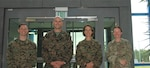 Marine Maj. Jon Smith, left,  Marine Lt. Col. Thomas Stona and Marine Col. Patrizia Dienhart-Stabile with the U.S. Marine Corps Forces Europe and Africa are greeted by Army Lt. Col. Katie Dlugosz, right, at Defense Logistics Agency Distribution Europe October 7, 2021.