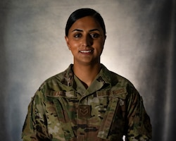 Senior Airman Ramandeep Kaur, assigned to the Office of Special Investigations 242nd Detachment Locally Employed Persons Screening Team, poses for a photo at Ali Al Salem Air Base, Kuwait, Oct. 19, 2021.