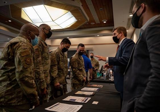 Airmen speak with civilians