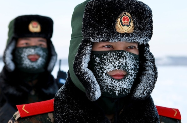 Chinese paramilitary police border guards train in the snow