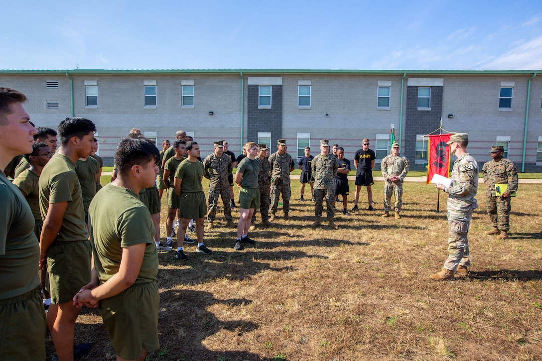 U.S. Army Capt. Joshua Love, company commander for 561st Military Police Company, 716th Military Police Battalion, 16th Military Police Brigade, 101st Airborne Division, reads a certificate to the Marines of Marine Wing Support Squadron 273 to recognize them for their help and cooperation with the 561st Military Police Co. on Fort Pickett, Virginia, Oct. 22, 2021.