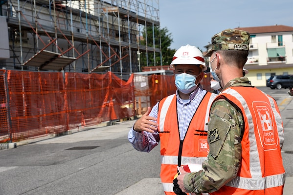 U.S. Army Corps of Engineers, Europe District Southern Europe Area Engineer Bryce Jones discusses nearby ongoing construction at Caserma Ederle, part of U.S. Army Garrison Italy in the Vicenza area, during a tour of the installation with Europe District Commander Col. Pat Dagon June 9, 2021. Jones was recognized as the U.S. Army Corps of Engineers Administrative Contracting Officer of the Year during a virtual ceremony October 25, 2021 for his work in support of the U.S. Army Corps of Engineers missions in Italy as well as several other Southern European countries. (U.S. Army photo by Chris Augsburger)