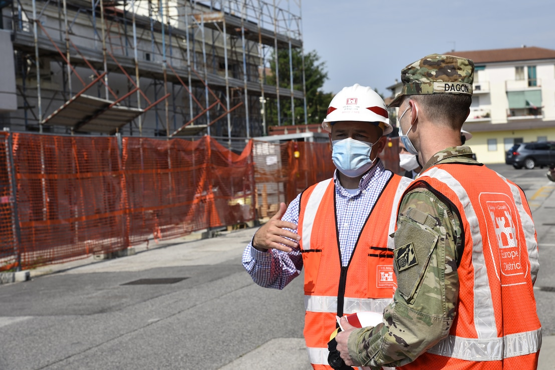U.S. Army Corps of Engineers, Europe District Southern Europe Area Engineer Bryce Jones discusses nearby ongoing construction at Caserma Ederle, part of U.S. Army Garrison Italy in the Vicenza area, during a tour of the installation with Europe District Commander Col. Pat Dagon June 9, 2021. Jones was recognized as the U.S. Army Corps of Engineers Administrative Contracting Officer of the Year during a virtual ceremony October 25, 2021 for his work in support of the U.S. Army Corps of Engineers missions in Italy as well as several other Southern European countries. (U.S. Army photo by Chris Augsburger) (Chris Augsburger)