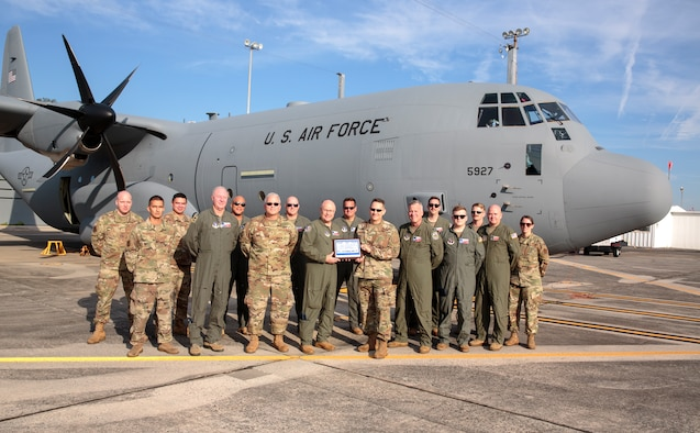 U.S. Air Force Col. Blair Morris (right), Lockheed Martin Marietta Defense Contract Management Agency commander,  relinquishes C-130J Super Hercules 5927 to Texas Air National Guard Col. Keith Williams (left), 136th Airlift Wing commander, Oct. 14, 2021, in Marietta, Georgia. The C-130J aircraft will introduce upgraded avionics, smaller aircrew requirements, more cargo space and increased longevity.  (Courtesy photo from Lockheed Martin, Thinh D. Nguyen)