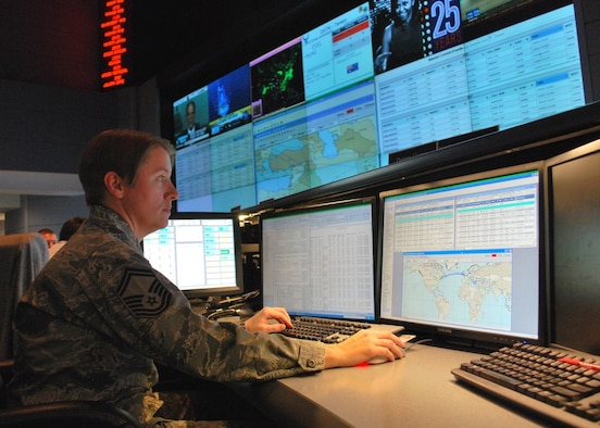 Senior Master Sgt. Donna Crone, pictured here at the 618th Air and Space Operations Center (Tanker Airlift Control Center) at Scott Air Force Base, Ill., works at her desk in TACC, Dec. 16, 2010. She is one of many planners and operators responsible for centralized command and control of Air Force and commercial contract air mobility assets 24 hours a day. The 618th AOC plans, schedules and tracks tanker, airlift and aeromedical evacuation aircraft worldwide to accomplish AMC's global reach mission.