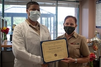 Leadership at Naval Health Cherry Point recognized two staff members Friday, August 27 for their excellent performance and contributions to patient safety while serving aboard Marine Corps Air Station Cherry Point.    Hospitalman Kiya F. Smith a member of the clinic's Laboratory Staff was presented a certificate and coin from Navy Capt. Elizabeth Adriano, the clinic's commander.