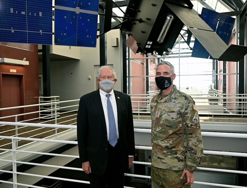 Secretary of the Air Force Frank Kendall stands with Lt. Gen. Stephen Whiting, commander of Space Operations Command, in front of a Space-Based Infrared System model at Peterson Space Force Base, Colo., Aug. 18, 2021. During his first visit to Peterson SFB, Kendall met with U.S. Space Command, U.S. Northern Command and SpOC leadership, as well as Airmen and Guardians to recognize their roles in protecting the nation. (U.S. Air Force photo by Wayne Clark)