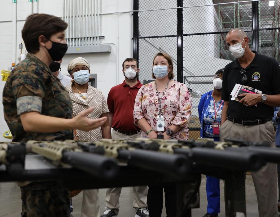 U.S. Marine Corps Logistics and Headquarters Defense Logistics Agency teams discuss technology.