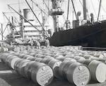 oil barrels line a pier