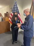 Wendy Chaves, head of the Office of Research, Development, Test & Evaluation and Innovation was presented a Coast Guard Civilian Service Commendation Medal by Rear Adm. J.M. Kelly for her work to establish a Coast Guard detachment at the Defense Innovation Unit (DIU) July 28, 2021.