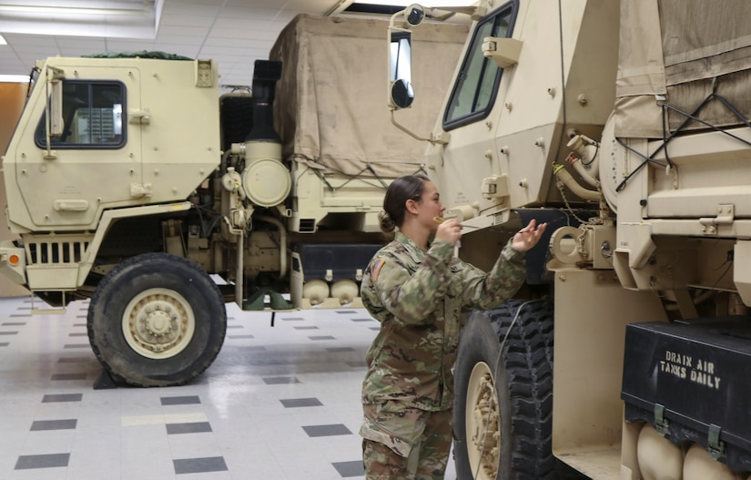Spc. Stephanie Sparrow, a wheeled vehicle repairer with 3622nd Support Maintenance Company, 728th Combat Sustainment Support Battalion, 213th Regional Support Group, Pennsylvania Army National Guard, checks the oil on one of the eight high-clearance vehicles her unit has readied to respond to Tropical Storm Ida Sept. 1 at Fort Indiantown Gap. About 120 Pennsylvania National Guard members total with approximately 35 vehicles have been placed on state active duty and are on stand-by as Ida bears down on Pennsylvania. (U.S. Army National Guard photo by Staff Sgt. Zane Craig)