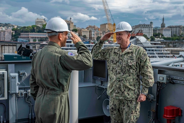 (Aug 31, 2021) Capt. Daniel Prochazka, commanding officer of the Blue Ridge-class command and control ship USS Mount Whitney (LCC 20) salutes Vice Adm. Gene Black, commander, U.S. Sixth Fleet, during the ship's change of command in San Giorgio Del Porto in Genoa, Italy, August, 31, 2021.  Mount Whitney, the U.S. Sixth Fleet flagship, homeported in Gaeta, Italy entered its regularly scheduled overhaul to make improvements in order to increase the security and stability of the U.S. Sixth Fleet area of operations.