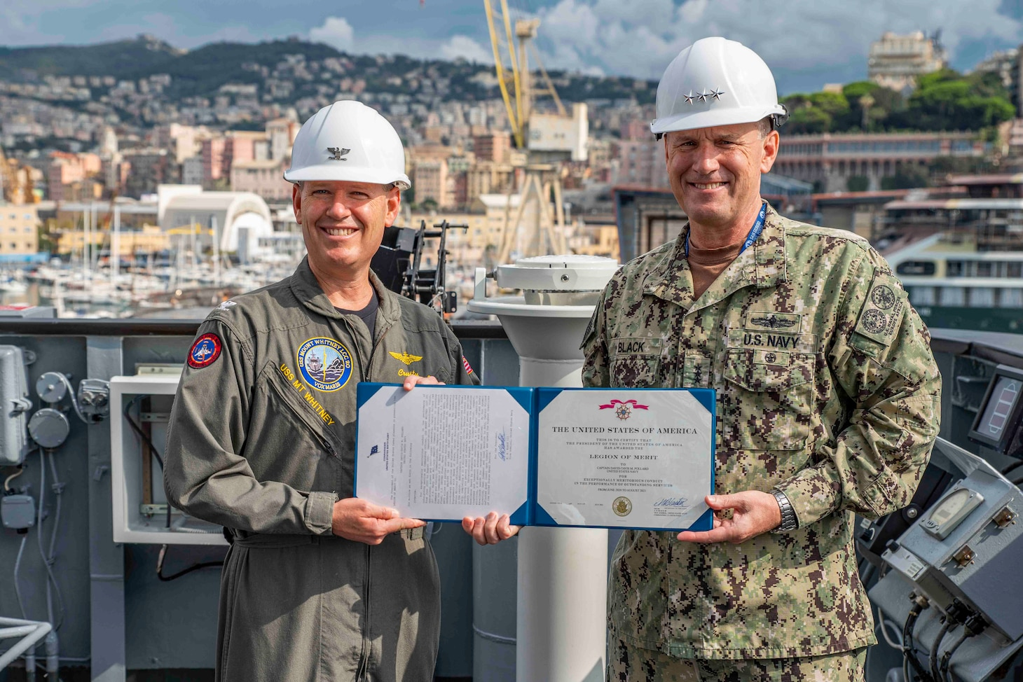 (Aug 31, 2021) Vice Adm. Gene Black, commander, U.S. Sixth Fleet, presents Capt. David Pollard, commanding officer of the Blue Ridge-class command and control ship USS Mount Whitney (LCC 20), with an award during the ship's change of command in San Giorgio Del Porto in Genoa, Italy, August, 31, 2021.  Mount Whitney, the U.S. Sixth Fleet flagship, homeported in Gaeta, Italy entered its regularly scheduled overhaul to make improvements in order to increase the security and stability of the U.S. Sixth Fleet area of operations.