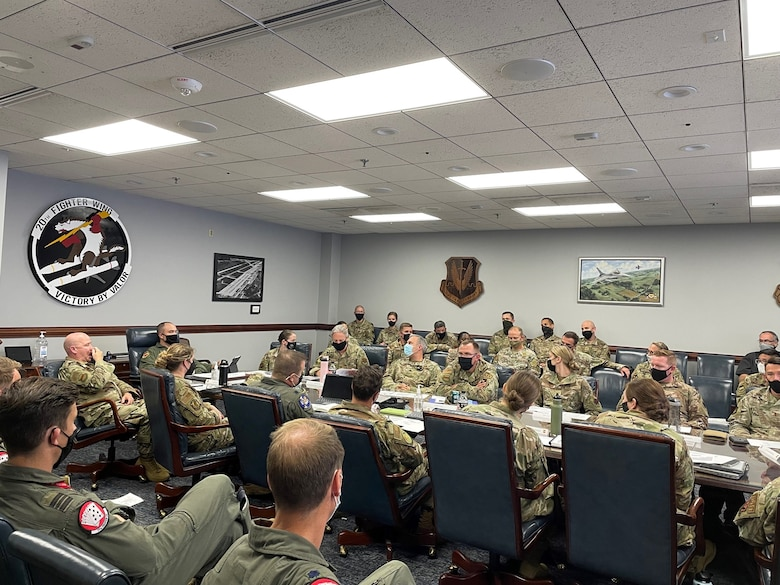 Photo of U.S. Air Force Airmen sitting at a table