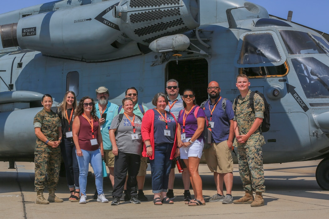 U.S. Marines and teachers visiting the Marine Corps Air Station Miramar as part of the Educators' Workshop pose for a group photo on MCAS Miramar, San Diego, California, July 14, 2021.
