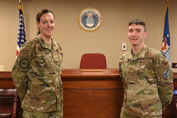 Capt. James McGehee, Malmstrom Air Force Base special victims' counsel, right, and Staff Sgt. Olga Vinson, Malmstrom AFB paralegal, pose for a photo inside of the courtroom at Malmstrom AFB, Mont. The SVC is a military attorney and paralegal team who operate outside of the installation's chain of command to represent victims of sexual assault, sexual harassment and interpersonal violence. (U.S. Air Force photo by Airman Elijah Van Zandt)