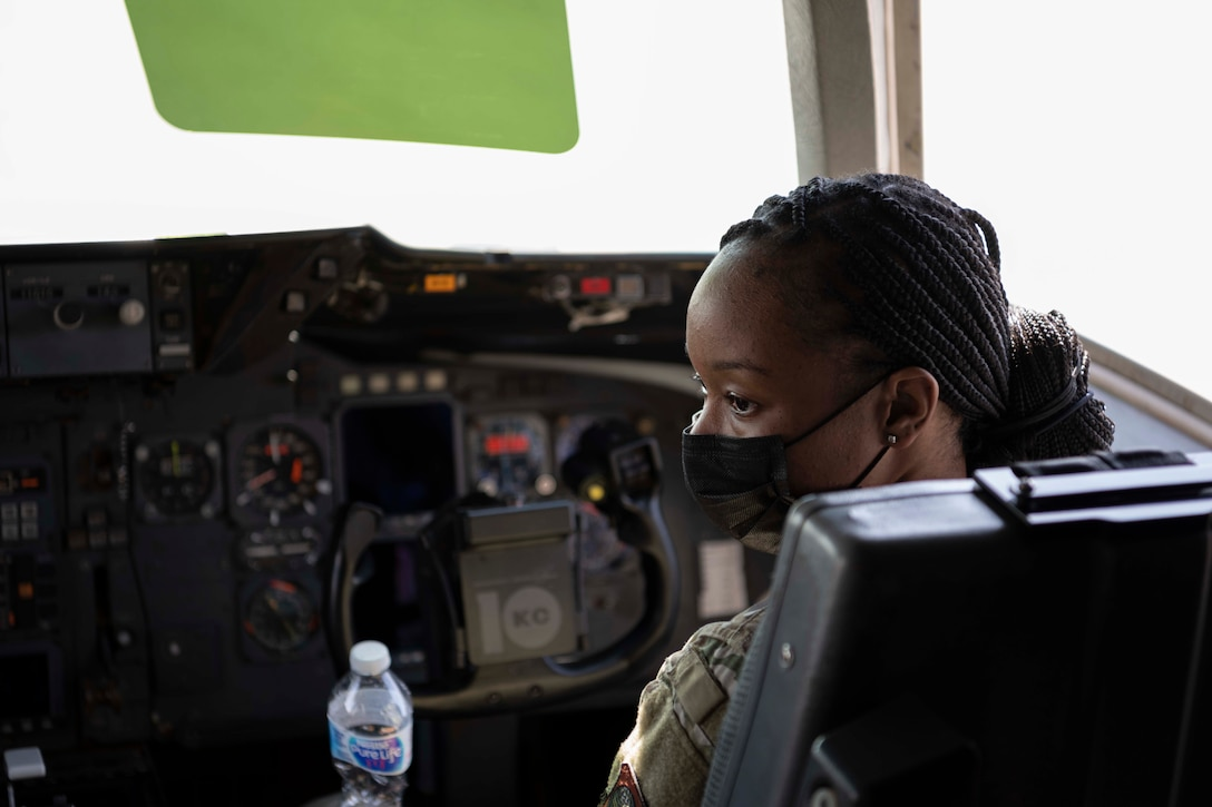 Airman sits in the co-pilots seat in an aircraft