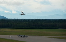 A Royal Australian Air Force E-7A Wedgetail prepares to land while U.S. Air Force F-35A Lighting IIs prepare to take off on Eielson Air Force Base, Alaska, Aug. 11, 2021. RAAF personnel last visited Alaska in 2019 to participate in RF-A 19-3, before the 354th Fighter Wing accepted its first F-35As. This time the Australians brought their own F-35As as well as EA-18G Growlers and an E-7A Wedgetail to exercise air-to-air combat as well as cyber and intelligence capabilities.(U.S. Air Force photo by Senior Airman Beaux Hebert)