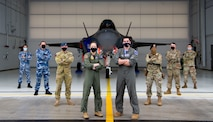Pilots, security forces, aircraft maintainers and logistics personnel from the Royal Australian Air Force (left) and the U.S. Air Force (right) pose in front of an F-35A Lightning II assigned to the 355th Fighter Squadron during RED FLAG-Alaska 21-3 on Eielson Air Force Base, Alaska, Aug. 27, 2021. This iteration of the exercise focused on the interoperability of allied fifth-generation assets, such as the F-35A Lightning II, as well as cyber and intelligence warfare capabilities. (U.S. Air Force photo by Senior Airman Beaux Hebert)