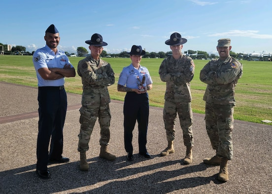 Sgt. Michelle Holt, center, poses for a photo with two fellow U.S. Space Force military training instructors on August 6, 2020, at Lackland Air Force Base, Texas.