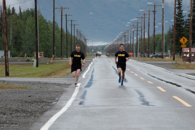 Col. Damon Delarosa (right), commander of the U.S. Army Corps of Engineers – Alaska District, and Capt. Justin Dermond (left), project engineer, race to the finish line of the two-mile run during the Army Combat Fitness Test on Aug. 17 at Joint Base Elmendorf Richardson.