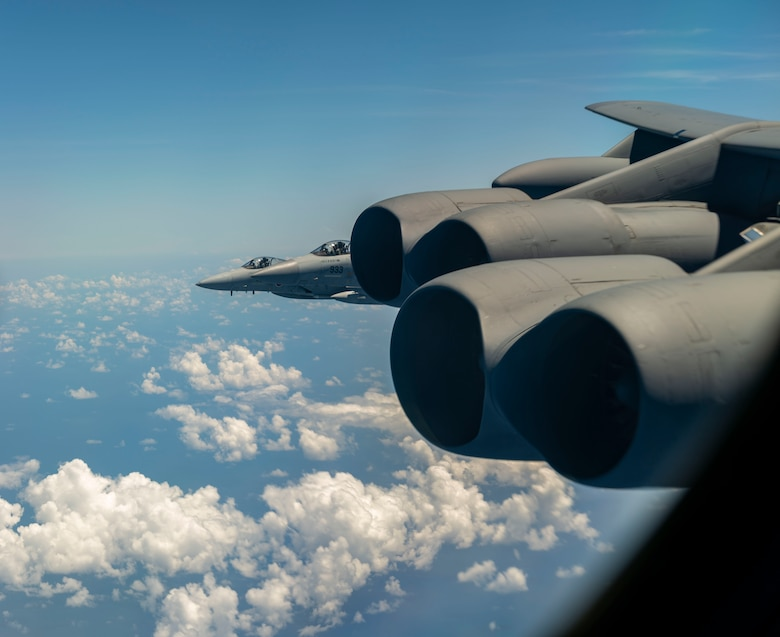Two Japan Air Self-Defense Force (JASDF) F-15's escort a U.S. Air Force B-52 Stratofortress August 31, 2021 over the Indo-Pacific region. The JASDF and the U.S. Air Force conducted bilateral training to enhance deterrence and response capabilities. (U.S. Air Force photo by Senior Airman Charles T. Fultz)