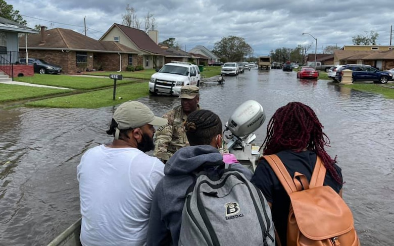 Louisiana National Guardsmen rescue people in LaPlace, Louisiana, in the aftermath of Hurricane Ida. More than 6,000 members of the National Guard from more than a dozen states were in Louisiana assisting state and federal partners with relief efforts.