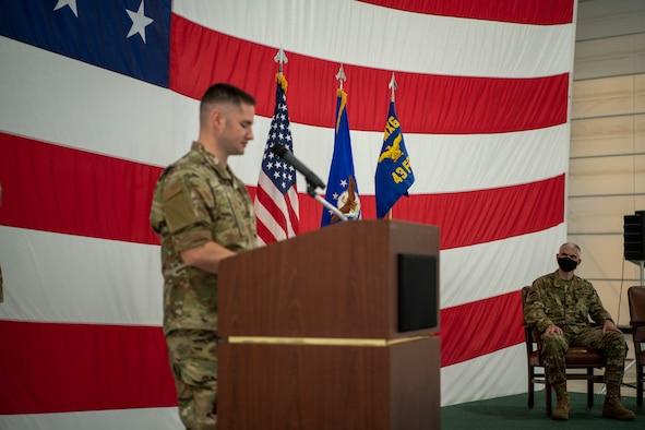 man stands at podium