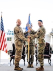 A change of command photo with Lt. Col. Rao