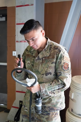 Senior Airman Joseph Vargas, 741st Maintenance Squadron mechanical and pneudraulics technician, inspects a component of a hydraulic actuator power unit July 28, 2021, at Malmstrom Air Force Base, Mont.